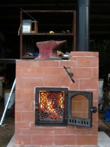 fire-going-in-hybrid-cabin-stove-225x300